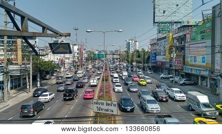 Bangkok Nonthaburi, Thailand, 14th March 2016. Dense traffic on one of the main roads through Bangkok Nonthaburi. Street crowded with cars, motorbikes, vans and trucks.
