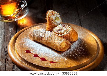 view of nice fresh hot crepes with fruit dessert  on color background