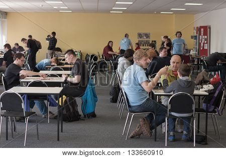 BRNO CZECH REPUBLIC - APRIL 30 2016: Unidentified people playing desk games in room of desk games at Animefest anime and manga convention on April 30 2016 Brno in the Czech Republic