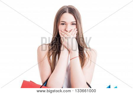 Portrait Of Young Shopping Woman With Hands Over Mouth