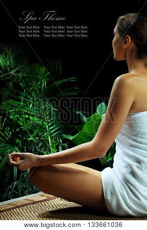 View of nice young woman meditating in spa environment, Banner, extra space for your text.