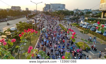 Ho-Chi-Minh-City (Saigon), Vietnam, 21st March 2016. An uncountable number of motorbikes filling an intersection on one of the main roads leading into the Asian mega-city Saigon.
