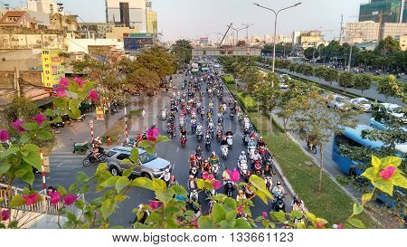Ho-Chi-Minh-City (Saigon), Vietnam, 21st March 2016. Dense Traffic and traffic jam as a daily routine at evening rush hour while sunset. Streets are filled with uncountable vehicles.