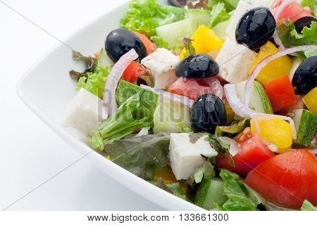 close up view of nice yummy salad on white back