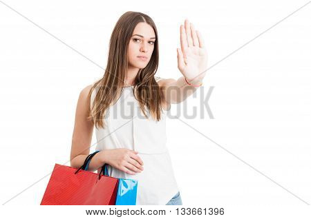 Young Serious Customer With Shopping Bags Making A Stop Sign