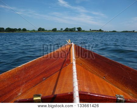 View from a rower in rowboat, looking to the blue sea.