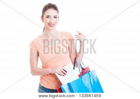 Young Woman Shopper Grabbing Tablet From Paper Bags