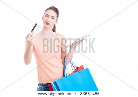 Woman Carrying Shopping Bags Showing Credit Or Debit Card