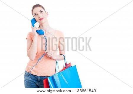 Pretty Lady Shopper Holding Telephone Receiver As Assistance Concept
