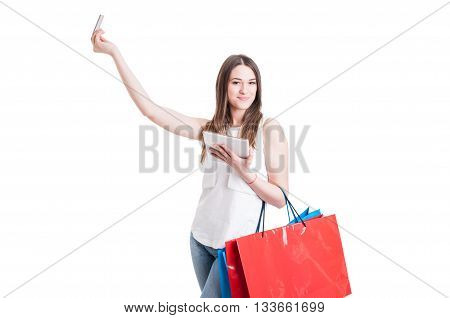 Internet Shopping Concept With Beautiful Shopper Using Card And Tablet