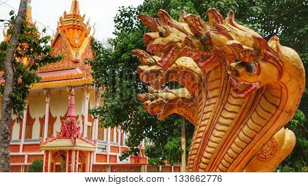 Golden Dragon Heads in front of a religious building in a Buddhist Pagoda in Vietnam