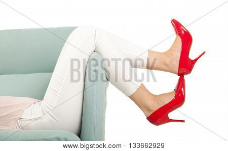 Woman Legs And Red High Heels On Sofa White Background