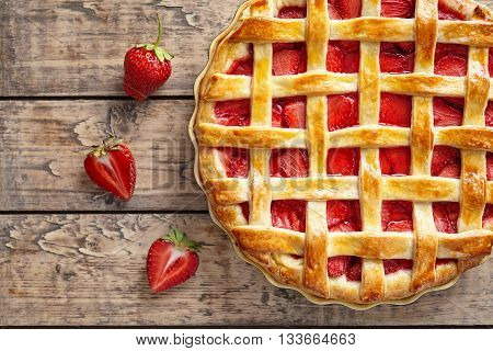 Summer strawberry pie tart cake traditional baked pastry food on rustic wooden table background