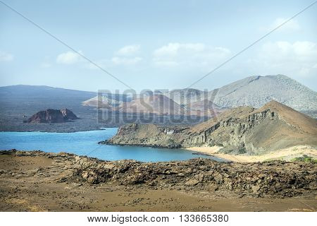 Galapagos landscape with mountains sea and blue sky