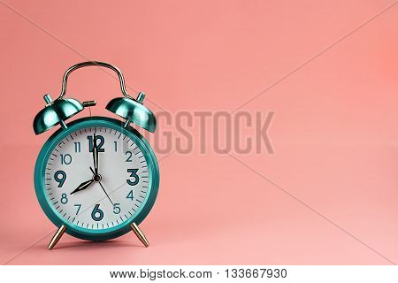 Vintage style alarm clock with copy space for text.