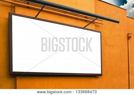 Blank advertising billboard on supermarket store exterior wall copy space for text of graphic design