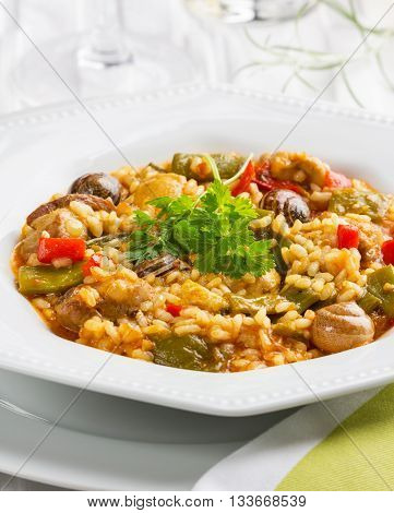Original rice paella fom Valencia with chicken and snails