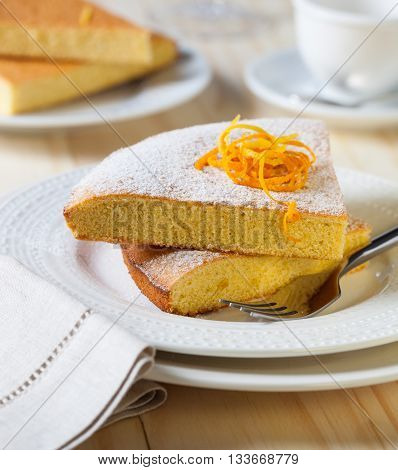 Plates with slices of lemon cake on a table
