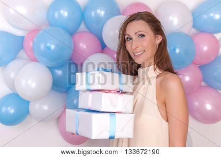 holding gift smiling camera