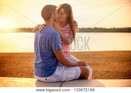 romantic flirting embracing younger couple