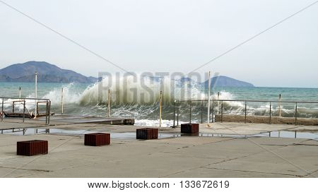 High tide on the Black Sea beating on the jetty in the Crimea