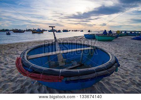 Basket boat in sunrise. MUI KE GA, BINH THUAN, VIETNAM