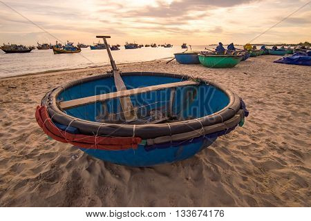 Basket boat in the sand. MUI KE GA, BINH THUAN, VIETNAM