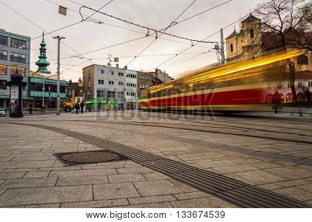 Blurred tram in the center of Bratislava, Slovakia in the evening. Famous old buildings.