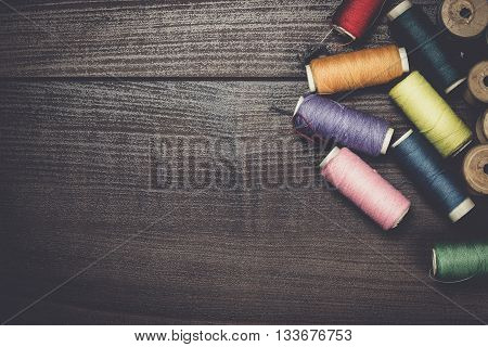 threads on the brown wooden table background