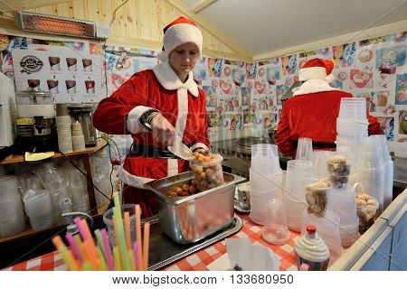 VILNIUS LITHUANIA - DECEMBER 7: Unidentified people trade food in annual traditional Christmas fair on December 7 2014 in Vilnius Lithuania
