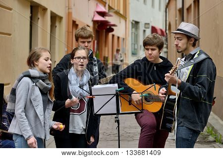 VILNIUS LITHUANIA - MAY 16: Unidentified musician play guitar in Street music day on May 16 2015 in Vilnius. Its a most popular event on May in Vilnius Lithuania