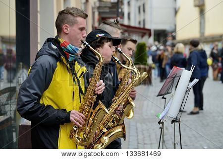 VILNIUS LITHUANIA - MAY 16: Unidentified musicians play Saxophone in Street music day on May 16 2015 in Vilnius. Its a most popular event on May in Vilnius Lithuania