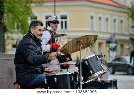 VILNIUS LITHUANIA - MAY 16: Unidentified musician plays drums and other instruments in Street music day on May 16 2015 in Vilnius. Its a most popular event on May in Vilnius Lithuania
