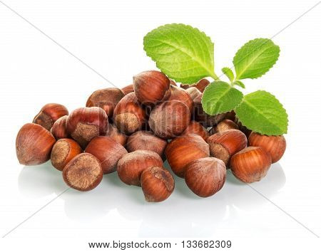 A pile of whole hazelnuts close-up isolated on white background.