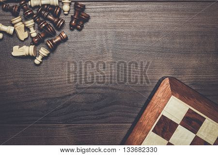 chess board and figures on woden background