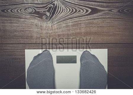 grey electronic scales on the wooden floor