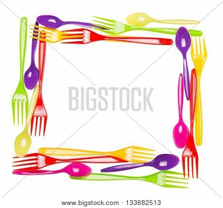 Plastic multi-colored spoons and forks laid out in the shape of the frame isolated on white background.