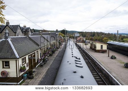 Looking down from footbridge to Boat of Garten Railway Station and along the Strathspey Railway in Scottish Highlands