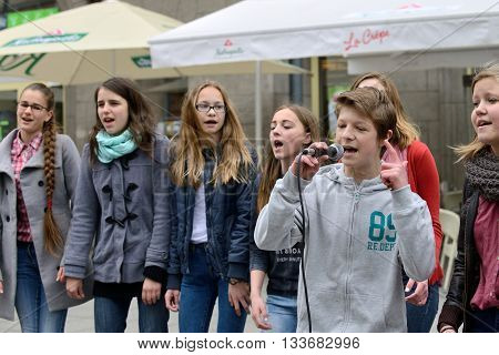 VILNIUS LITHUANIA - MAY 16: Unidentified musician sings and dancing in Street Music Day on May 16 2015 in Vilnius. Its a most popular event on May in Vilnius Lithuania
