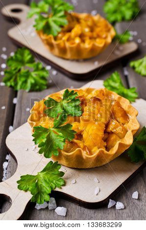 Homemade tartlet with corn on the wooden background. Selective focus.