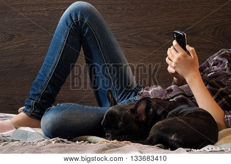 Legs, human hands, teenager. Mobile dog. Concept, idea - the convenience, comfort communication, communication