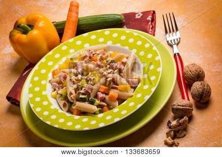 mixed salad pasta with pepper zucchinis carrots and walnuts