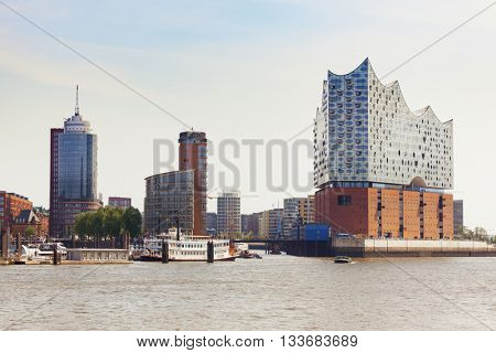 Hamburg, Germany - May 19, 2016: Western view of HafenCity quarter with the new Elbe Philharmonic Hall built on top of an old warehouse. The concert hall will be opened in late 2016.