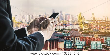 Businessman using smart phone with urban city background