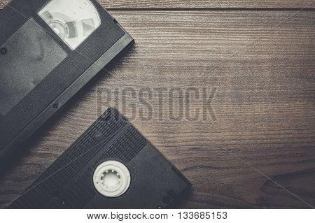 old retro video tape on the wooden background