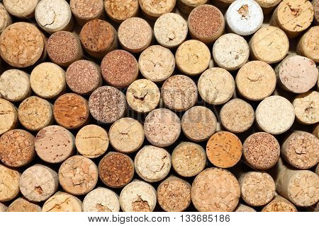 Background of used wine corks, wall of many different wine corks closeup
