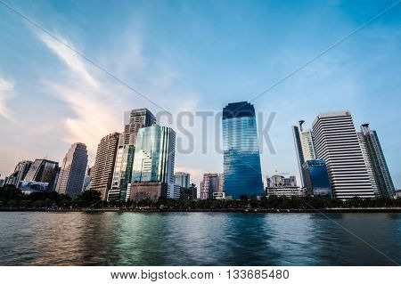 BANGKOK THAILAND - JUNE 7 2016 : view of city scape from lake park in center of bangkok (thai word in billboard is mean