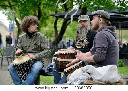 VILNIUS LITHUANIA - MAY 16: Unidentified musician plays drums in Street Music Day on May 16 2015 in Vilnius. Its a most popular event on May in Vilnius Lithuania