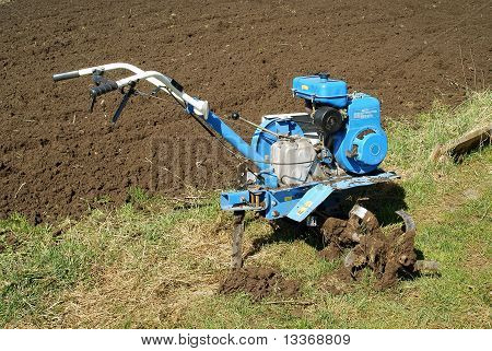 Motor-cultivator at the ploughed kitchen garden