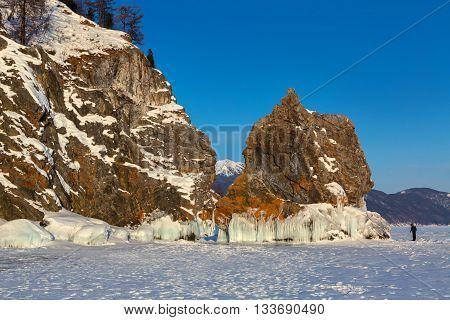 Ice covered island Lohmaty. Beautiful winter landscape in the Lake Baikal.